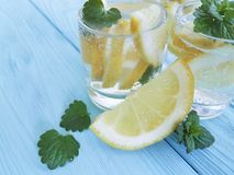 Water fresh lemon, mint refreshing homemade blue wooden background summer drink. Water fresh lemon, mint on a blue wooden background, summer homemade refreshing Stock Photography