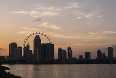 Water front sunset of Singapore skyline a modern urban city Stock Images
