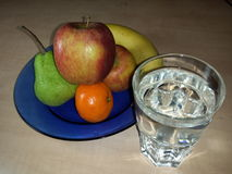 Water and fruits for office at night shift Royalty Free Stock Photography