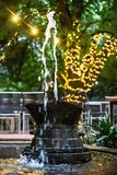 Water feature with Bokeh lights. Water feature made from old farm tools with bokeh lights in background stock photos