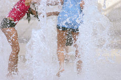 Water fun. Couple of young girls playing and having some fun at the water park Royalty Free Stock Photo