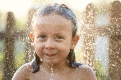 Water fun. girl in the shower splashing water. Water fun. girl in the shower splashing water Stock Photo