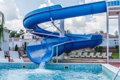 Water fun in the pool, slide. Concept, cheerful, perky bright colorful summer and relaxation. View from above.  stock image
