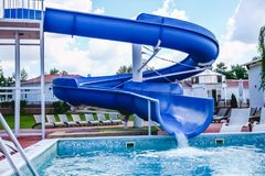 Water fun in the pool, slide. Concept, cheerful, perky bright colorful summer and relaxation. View from above.  royalty free stock image