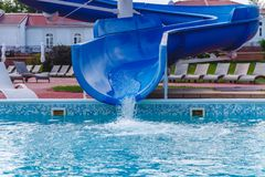 Water fun in the pool, slide. Concept, cheerful, perky bright colorful summer and relaxation. View from above.  royalty free stock photo