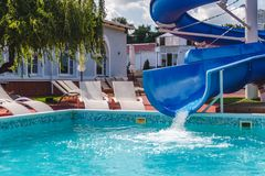Water fun in the pool, slide. Concept, cheerful, perky bright colorful summer and relaxation. View from above.  stock photography