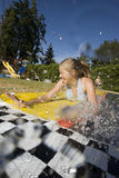 Water fun with young girl Royalty Free Stock Images