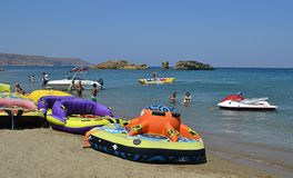 Water funnny sports. A banana boat and othe new funnny leisure activities for tourists in Greece. This is Vai beach, one of the most popular beaches in Crete Royalty Free Stock Photography