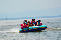 Water funnny sports. A banana boat and other new funny leisure activities for tourists in thai Royalty Free Stock Photo