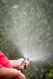 Water from a garden hose Royalty Free Stock Image