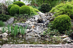 Water garden with waterfall and a stream Royalty Free Stock Image