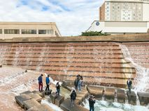 Water Gardens in downtown Fort Worth with visitors. FORT WORTH, TX, US-DEC 24, 2018:Water Gardens in downtown Fort Worth with visitors. A beautiful and royalty free stock photography