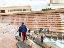Water Gardens in downtown Fort Worth with visitors. FORT WORTH, TX, US-DEC 24, 2018:Water Gardens in downtown Fort Worth with visitors. A beautiful and royalty free stock images