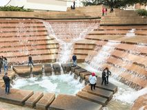 Water Gardens in downtown Fort Worth with visitors. FORT WORTH, TX, US-DEC 24, 2018:Water Gardens in downtown Fort Worth with visitors. A beautiful and royalty free stock image