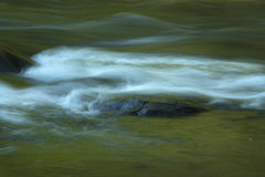 Water with gentle turbulence, Farmington River, Nepaug Forest, C. Water gently flowing in rapids with some turbulence; Farmington River; Nepaug Forest; New Royalty Free Stock Photos