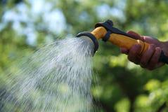 Water gevende tuin Stock Afbeelding
