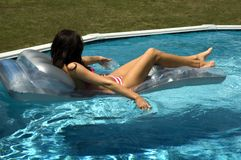 Water girl in pool. On float Stock Images