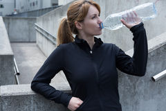 Water gives refreshment. Drinking water after physical exercises gives refreshment Stock Photos