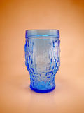 Water glass. Empty blue water cup made of glass stock image