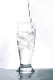 Water glass. Drink in movement. Liquid that it falls down in a glass Royalty Free Stock Photography