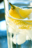 Water glass. With lemon and ice Stock Photos