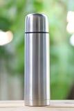 Water glass of aluminum (Aluminum mug) on wooden floor. Stock Photography
