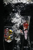 Water, Glass and Bubbles. An abstract image of two glass vases filled with pebbles on a black background with bubbles Royalty Free Stock Images