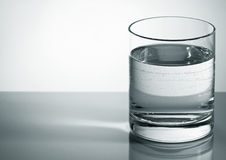 Water glass with bubbles Stock Photography