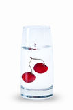 Water glass with cherry isolated with reflection Royalty Free Stock Photography