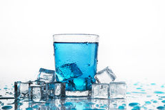 Water glass and cold ice cubes Stock Photography