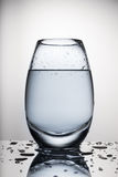 Water in a glass. With drops stock photography