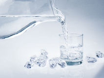 Water in glass with ice. Cold water in glass with ice Royalty Free Stock Photos