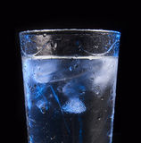 Water in glass with ice cubes Stock Photo