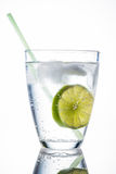 Water glass and lime. A glass of fresh drinking water and a lime. mineral water as a thirst quencher Royalty Free Stock Photography