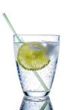 Water glass and lime. A glass of fresh drinking water and a lime. mineral water as a thirst quencher Royalty Free Stock Images