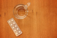 Water glass and medicaments. The Water glass and medicaments Royalty Free Stock Photo