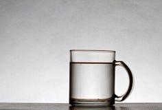 Water Glass Mug. A water glass mug on gray background Royalty Free Stock Photography