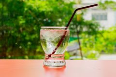 Water glass on nature background. Royalty Free Stock Photo