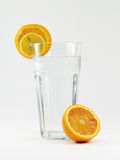 Water glass with orange. Glass of pure water with orange slices Royalty Free Stock Image