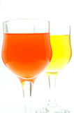 Water glass with orange and yellow colors Royalty Free Stock Photos