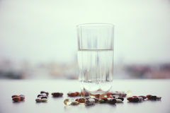 Water glass and pills Royalty Free Stock Photo