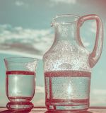 Water in a glass and in a Pitcher. Royalty Free Stock Image