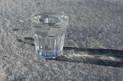 Water glass on rock Royalty Free Stock Image