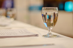 Water glass in the seminar room Stock Image