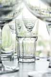 Water glass on the shelves , Drinking water container, Empty wat Stock Images