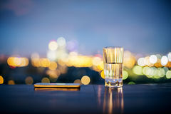 Water glass and smartphone Stock Photos