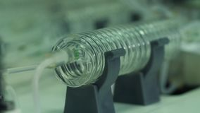 Water in a glass spiral tube. In a laboratory stock video