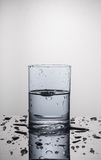 Water in a glass. Water splash in a glass stock photo