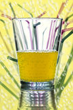 Water glass with straws in the background Royalty Free Stock Photography