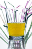 Water glass with straws in the background Royalty Free Stock Image
